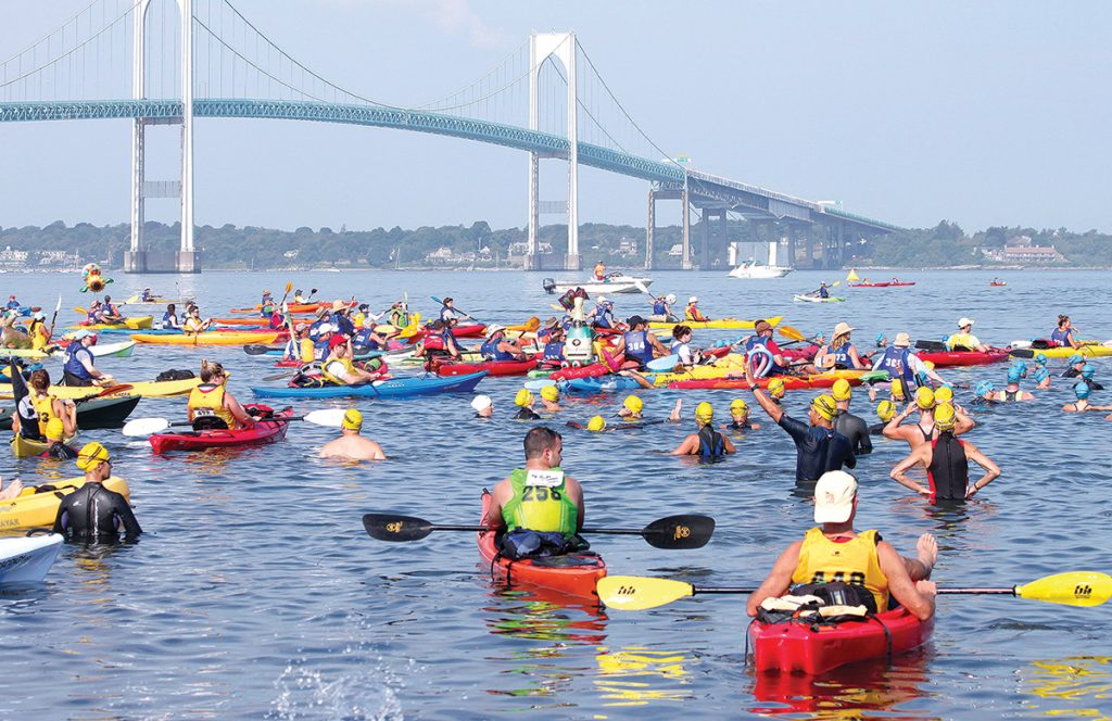SWIM CHALLENGE: Swimmers and kayakers in the fourth wave of the 40th Save The Bay Swim get ready to traverse their course from Newport to Jamestown. The 43rd annual installment of the swim will be held July 27. / COURTESY SAVE THE BAY INC.