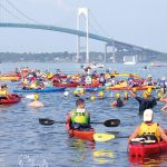 SWIM CHALLENGE: Swimmers and kayakers in the fourth wave of the 40th Save The Bay Swim get ready to traverse their course from Newport to Jamestown. The 43rd annual installment of the swim will be held July 27.