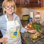 STUFFED QUAHOGS: Cheryl Ursillo, founder and CEO of Grace's Stuffies, makes gourmet stuffed quahogs using her mother's recipe. / PBN PHOTO/MICHAEL SALERNO