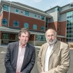NEW STATION: Raymond Lavoie, left, executive director, and Dr. Michael Fine, senior clinical and population health officer, stand in front of Blackstone Valley Community Health Care's new neighborhood health station in Central Falls. / PBN PHOTO/MICHAEL SALERNO