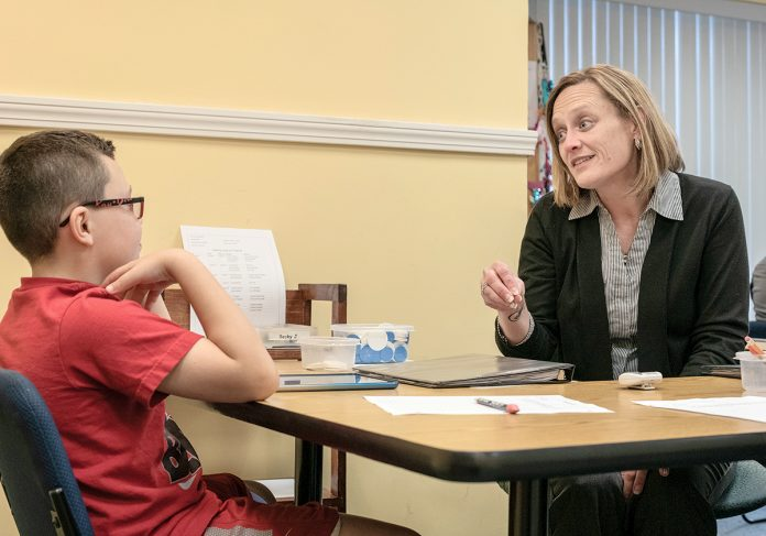 ONE-ON-ONE: Rebecca Johnson, franchise owner of Sylvan Learning Center in Coventry, meets one-on-one with Caden Reis, 8, of Coventry. Johnson began working under previous franchise owner Gail Tuominen before taking over two franchise locations, in Coventry and Cumberland. / PBN PHOTO/MICHAEL SALERNO