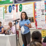 GETTING INVOLVED: Parent Yulaana Perez speaks during a public forum on the Johns Hopkins Institute for Education Policy report on Providence schools. R.I. education commissioner Angélica Infante-Green and Mayor Jorge O. Elorza listen in the background. / PBN PHOTO/MICHAEL SALERNO