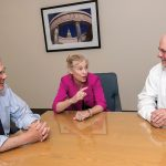 MANAGING PARTNERS: Cameron & Mittleman attorneys and managing partners, from left, Robert A. Migliaccio, Lynn E. ­Riley and Scott F. Bielecki converse at the Providence law firm. The firm has expanded practice areas as it added attorneys. 