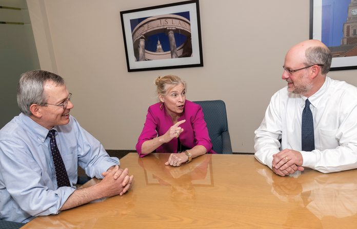 MANAGING PARTNERS: Cameron & Mittleman attorneys and managing partners, from left, Robert A. Migliaccio, Lynn E. Riley and Scott F. Bielecki converse at the Providence law firm. The firm has expanded practice areas as it added attorneys.   / PBN PHOTO/MICHAEL SALERNO