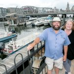 DRAMATIC CHANGE: Tom McGinn, captain and president, and Kristin Stone are co-owners of Providence Riverboat. After the company joined the Providence Warwick Convention & Visitors Bureau, it shifted its business model from cocktail cruises to catering to the tourism industry and nearly tripled its revenue in the first year, Stone said. / PBN PHOTO/MICHAEL SALERNO