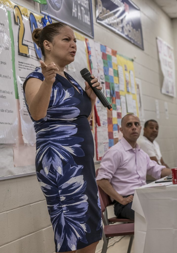 ANGÉLICA INFANTE-GREEN, the new state education commissioner, will request authority Tuesday from the Council on Elementary and Secondary Education to intervene in the Providence public schools. Behind her above, is Providence Mayor Jorge. O. Elorza./ PBN FILE PHOTO/MICHAEL SALERNO