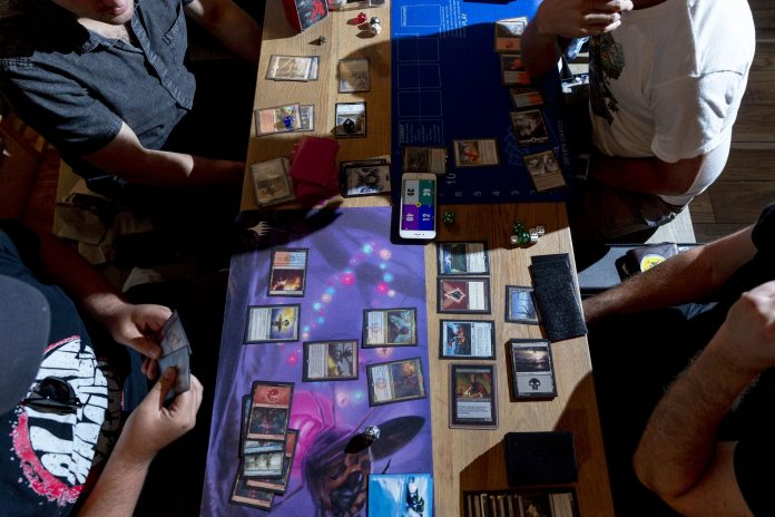 HASBRO IS LOOKING to grow its top and bottom lines with a decades-old game, Magic: The Gathering. But unlike tournaments in which players use paper cards, Hasbro has digitized the game and is informally naming it Arena. The company expects to be attracting millions of players in the next few years. / BLOOMBERG NEWS PHOTO/MARK ABRAMSON