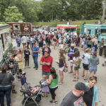 NEWPORT has voted to grant permits to food trucks and carts. Above, a crowd gathers at a Friday night food truck gathering at Roger Williams Park in Providence in 2016. / PBN FILE PHOTO/