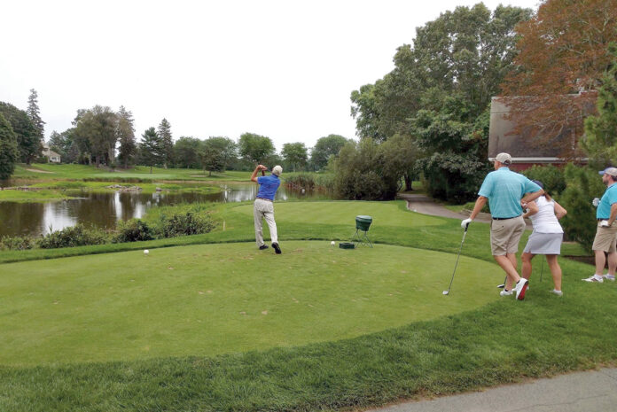 ANNUAL TOURNAMENT: Golfers tee off during a previous North Kingstown Chamber of Commerce Golf Tournament. This year's tournament will be held at Quidnessett Country Club in North Kingstown on Aug. 5.