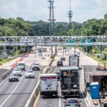 NEW GANTRY: Vehicles pass underneath an electronic truck-tolling gantry on Route 6 in Providence over the Woonasquatucket River Bridge. The gantry is scheduled to begin operating this month.