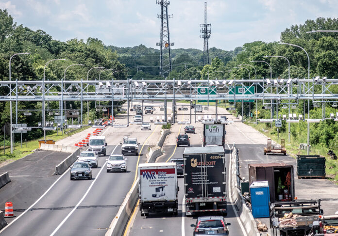 NEW GANTRY: Vehicles pass underneath an electronic truck-tolling gantry on Route 6 in Providence over the Woonasquatucket River Bridge. The gantry is scheduled to begin operating this month. / PBN PHOTO/MICHAEL SALERNO