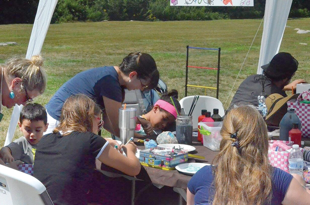 ENGAGED: Children work on crafts during a previous Adoption Rhode Island Duffle Bag Bash fundraiser. This year's event will be held Aug. 11 at Matunuck Community Center in South Kingstown. / COURTESY ADOPTION RHODE ISLAND