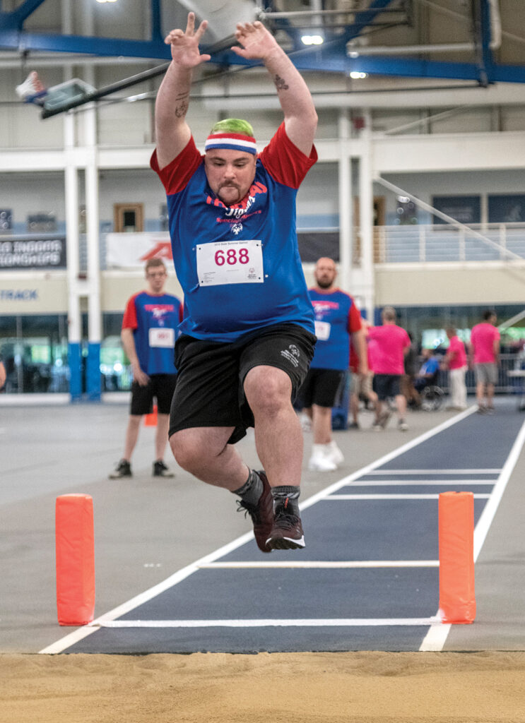 BIG LEAP: Andrew Palumbo of Warwick competes in the long jump for the Trudeau Tigers, at the Special Olympics Rhode Island Summer Games earlier this year. / PBN PHOTO/MICHAEL SALERNO