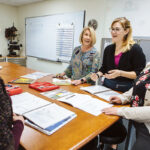 JOB TRAINING: We Make RI staff, from left: Diana Castellone, marketing specialist; Barbara Jackson, executive director; Katelyn Boudreau, vice president of employer relations; and Samantha Gobin, outreach coordinator, meet at the nonprofit's Cranston offices. / PBN PHOTO/RUPERT WHITELEY