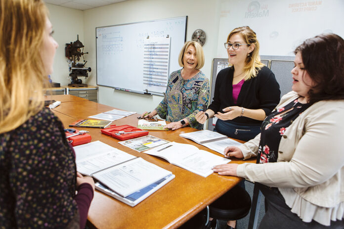 JOB TRAINING: We Make RI staff, from left: Diana Castellone, marketing specialist; Barbara Jackson, executive director; Katelyn Boudreau, vice president of employer relations; and Samantha Gobin, outreach coordinator, meet at the nonprofit's Cranston offices.