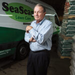 Jim Wilkinson has been in the lawn fertilization business for almost 50 years, but it wasn't always easy to make ends meet, especially when he started out as a teacher of golf course management at the college level. After working in the corporate world, he decided to create SeaScape nearly 25 years ago. It now has more than 10,000 customers in southern New England. / PBN PHOTO/RUPERT WHITELEY
