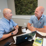 THREADING A NEW NEEDLE: Ocean State Innovations uses a novel approach to find success in the textile industry, thanks in large part to ownership partner Ben L. Galpen, left, and Edward W. Ricci II, CEO and partner.