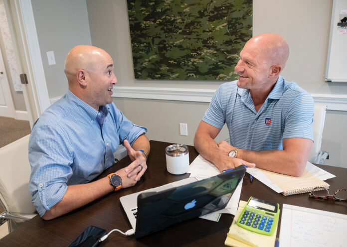 THREADING A NEW NEEDLE: Ocean State Innovations uses a novel approach to find success in the textile industry, thanks in large part to ownership partner Ben L. Galpen, left, and Edward W. Ricci II, CEO and partner. / PBN PHOTO/MICHAEL SALERNO