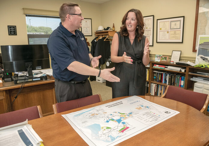 MAKING PLANS: Chelsea Siefert, Quonset Development Corp.'s new planning director, speaks with Steven King, managing director. / PBN PHOTO/MICHAEL SALERNO