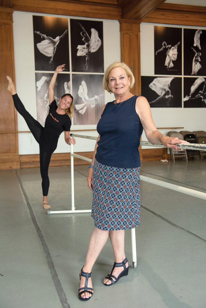 ON THE MOVE: Island Moving Company founder and Artistic Director Miki Ohlsen, with company dancer Emily Baker in the background. The ballet performance company is planning and fundraising for a new $4 million building that would include three studios as a black box theater and provide a home for its Newport Academy of Ballet. / PBN PHOTO/DAVE HANSEN