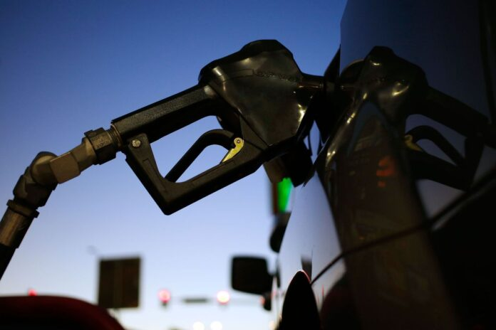 THE AVERAGE price of regular gas in Rhode Island declined 2 cents this week to $2.71 per gallon. / BLOOMBERG NEWS FILE PHOTO/ LUKE SHARRETT