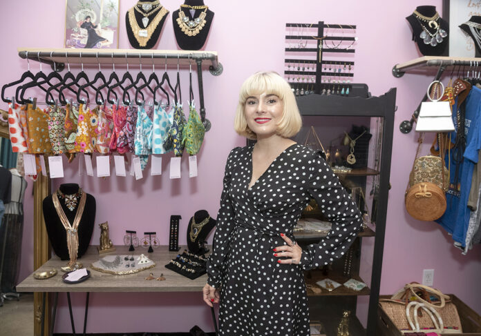 CUSTOM DESIGNS: Brianna Moon, CEO and designer of Brianna Moon custom apparel and jewelry, opened a space in the Hope Artiste Village in Pawtucket in June to sell her creations.