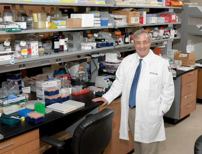 LAB WORK: Dr. Jack A. Elias, a top administrator at Brown University's Warren Alpert Medical School, is also considered a leader in research designed to be put to use in doctors' offices and hospitals to improve health outcomes.