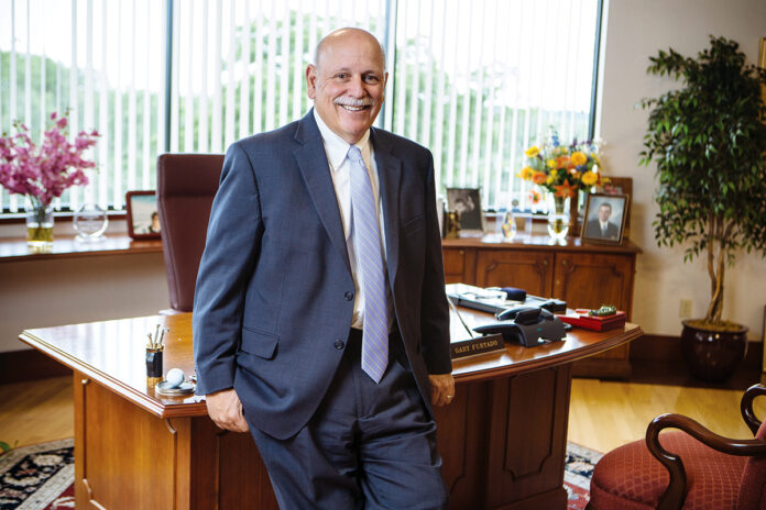 ON HIS WATCH: Gary E. Furtado has overseen tremendous growth at Smithfield-based Navigant Credit Union in his more than 30 years as CEO and president. / PBN PHOTO/RUPERT WHITELEY
