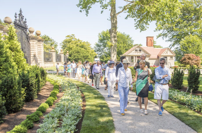 PRESERVATION SOCIETY OF NEWPORT COUNTY CEO and Executive Director Trudy Coxe, center, walks along the restored serpentine path at the Breakers with Hope
