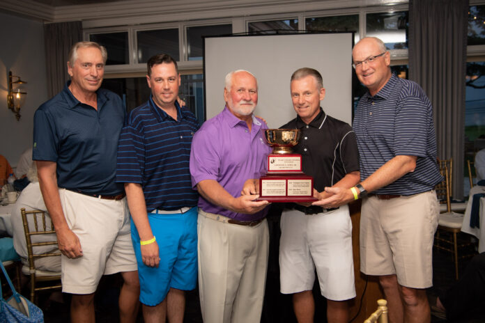 LAWRENCE A. AUBIN, center, co-chair of the Hasbro Children's Hospital Invitational and chairman of the Lifespan Board of Directors, presents the Aubin Cup to this year's 1st place team, Cox Business. From left to right: Mike Rigney, Jason Rowe, Larry Aubin, Jim Manchester, and Jamie Foster. / COURTESY HASBRO CHILDREN'S HOSPITAL