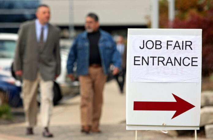 RHODE ISLAND had the second-highest unemployment rate in New England, despite a nearly half-percentage point decline year over year. / BLOOMBERG FILE PHOTO/TIM BOYLE