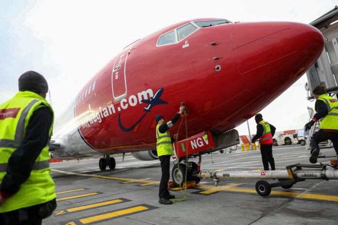 NORWEGIAN AIR is ending its trans-Atlantic service, including its flights to T.F. Green Airport. / BLOOMBERG NEWS FILE PHOTO/SIMON DAWSON