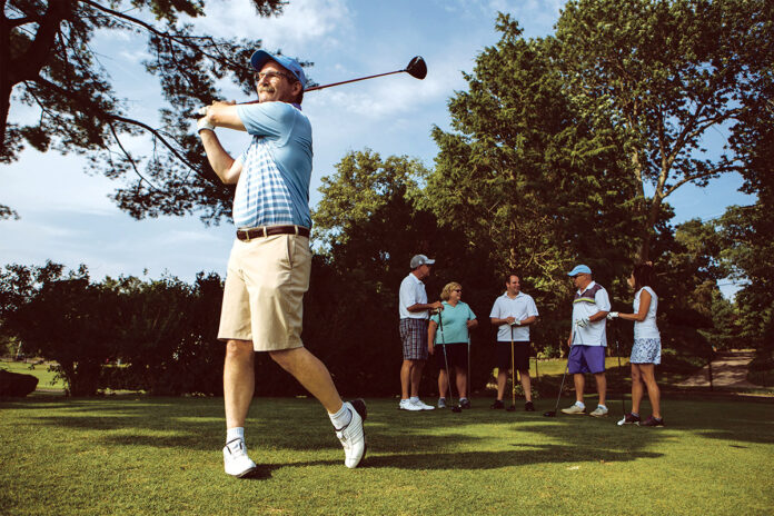 SWING OF THINGS: In their leisure time, employees at Parkinson Technologies participate in a golf league at Chemawa Golf Course in North Attleboro. Joe Connelly, Parkinson product development manager, tees off.