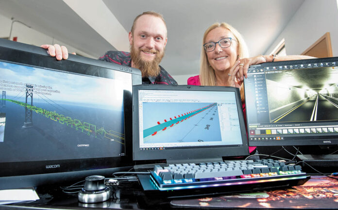 A MODEL COMPANY: Thomas Steere, a 3D computer-aided design specialist, left, and his mother, Patricia Steere, president of Steere Engineering Inc., display a virtual-reality rendering of the Mount Hope Bridge, and a computer-aided design model of the Sumner Tunnel in Boston, in the firm's Warwick office.