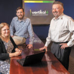 MEETING OF MINDS: Vertikal6 CEO Rick Norberg, right, with applications developer James Green and senior consultant Meredith Carroll.