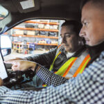 PLANNING AHEAD: Nate Fiske, right, Case Snow Management Inc. regional director of operations, and shop foreman Ken Maynard equip one of the company's trucks with a tablet loaded with Case's management software.