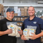 DEDICATED DUO: Brothers Galen, left, and Sennen Conte display bags of the whole pumpkin seeds that are part of the product line offered by Gerbs Allergy Friendly Foods. The Contes are co-owners of the business.