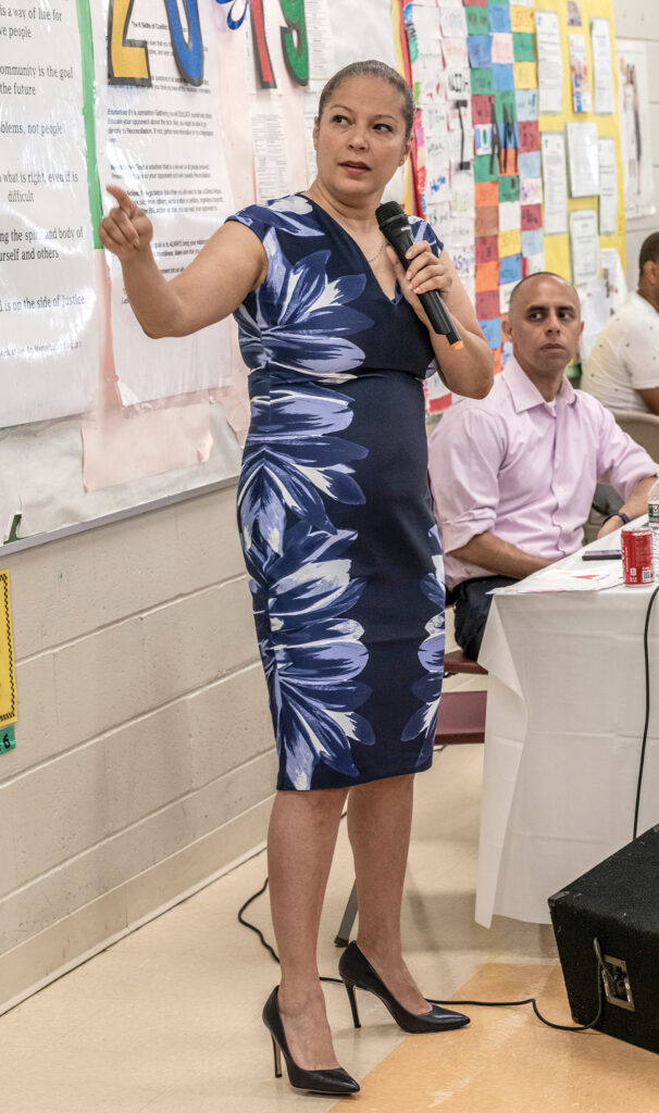 PUBLIC FORUM: Angélica Infante-Green, R.I. commissioner of education, speaks during a public forum on the Providence schools report by the Johns Hopkins Institute for Education Policy, as Mayor Jorge O. Elorza looks on. / PBN FILE PHOTO/MICHAEL SALERNO