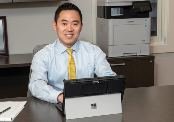 PRIVATE PRACTICE: Clinical psychologist Phillip Dang, owner of Aspire Psychological and Executive Coaching Services in East Greenwich, is currently on active duty in the U.S. Navy but is considering leaving when his current term is up to focus solely on private practice. / PBN PHOTO/MICHAEL SALERNO
