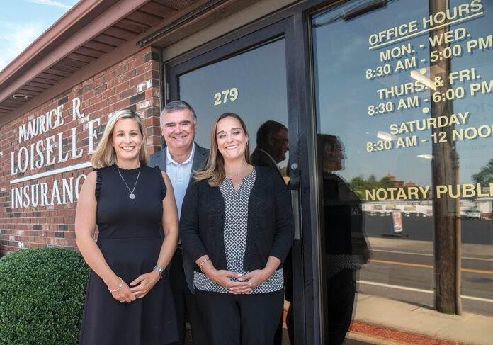 GENERATIONAL LEADERSHIP: Robert Loiselle, president of Loiselle Insurance Agency in Pawtucket, runs the business with his two daughters, who both serve as vice presidents, Melanie Loiselle-Mongeon, left, who also serves as office administrator, and Brenda Loiselle-Marcotte. All three are owners of the company.   / PBN PHOTO/MICHAEL SALERNO