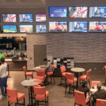 SPORTS BETS placed in Rhode Island resulted in gamblers losing $851,788 in August. Above, guests relax in a lounge at the sportsbook at Twin River Casino Hotel in Lincoln. 