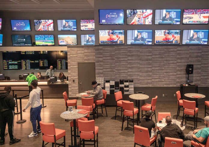 SPORTS BETS placed in Rhode Island resulted in gamblers losing $851,788 in August. Above, guests relax in a lounge at the sportsbook at Twin River Casino Hotel in Lincoln.  / PBN FILE PHOTO/MICHAEL SALERNO
