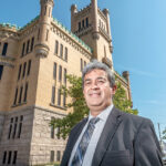 SIGNIFICANT IMPACT: Rhode Island Hispanic Chamber of Commerce CEO and President Oscar Mejias, who is also a member of a steering committee guiding the state in determining how to best put the Cranston Street Armory, above, to use, says its reopening will have a significant impact on the surrounding community. / PBN PHOTO/MICHAEL SALERNO