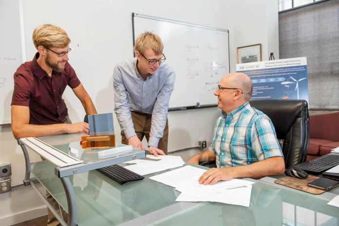 EFFICIENCY EXPERTS: Aquanis Inc. CEO Neal E. Fine, right, Chief Technology Officer John A. Cooney, center, and Senior Mechanical Engineer Christopher Szlatenyi are working on turbine blade designs that would make them more efficient.