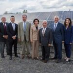 SOUTHERN SKY RENEWABLE ENERGY President Ralph Palumbo, second from right, voluntarily withdrew a no-bid contract this week with the city of Cranston. He is pictured here with, from left, North Providence Chief of Staff Richard Fossa, North Providence Town Council President Dino Autiello, R.I. Senate President Dominick J. Ruggiero, Gov. Gina M. Raimondo, North Providence Mayor Charles Lombardi, and Southern Sky Vice President Lindsay McGovern. They gathered in October at a Southern Sky solar panel array in North Providence. / COURTESY SOUTHERN SKY RENEWABLE ENERGY