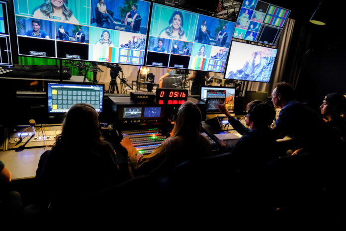 JEFF FOUNTAIN, second from right, instructor and manager of the newly renovated Broadcast Center at the University Rhode Island, works with students in the state-of-the-art control room. The Broadcast Center was officially unveiled Friday. / COURTESY UNIVERSITY OF RHODE ISLAND