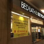 A SIGN IN THE WINDOW at Bed, Bath & Beyond in Providence Place mall announced the store's closing. PBN PHOTO/WILLIAM HAMILTON