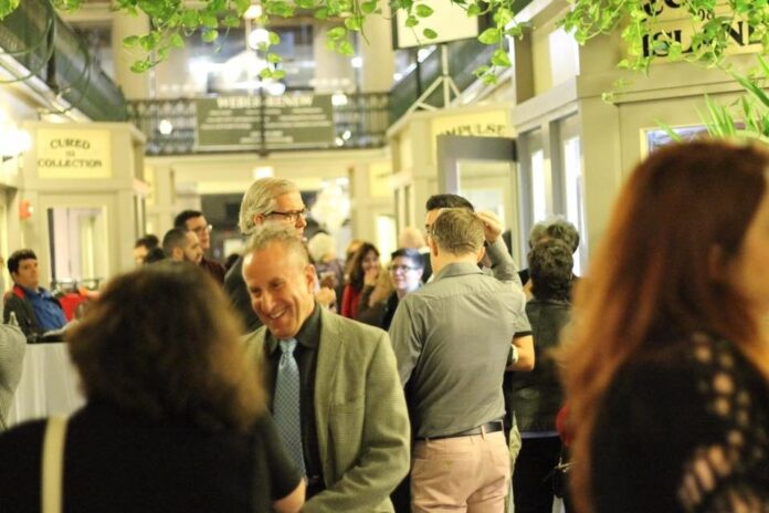 ATTENDEES MINGLE during a previous Project Weber/RENEW Celebrating CommUNITY event held at The Arcade in Providence. This year's event will take place Oct. 25 at Rooms & Works in Providence. / COURTESY PROJECT WEBER/RENEW