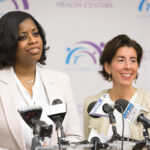 NEW ROLE: Womazetta Jones, left, who was nominated by Gov. Gina M. Raimondo, right, as secretary of the R.I. Executive Office of Health and Human Services and began her new role in late July, said there's an absolute necessity to better deliver services respectful of cultural and economic diversity. / COURTESY DAVID LEVESQUE