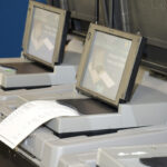 OPENING FOR HACKERS? The R.I. Board of Elections is studying whether modems added to voting machines in 2016 now represent a cybersecurity risk because they transmit encrypted data over the internet. / PBN PHOTO/MIKE SKORSKI